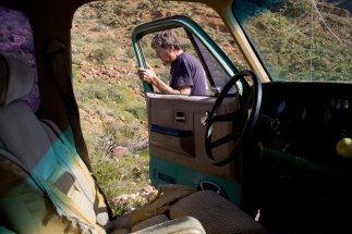 Jay Fraser returns to the seat of his GMC Suburban after scoping out the next patch in the road. Off-roading has become a popular, but some say destructive, pastime in Arizona's deserts.